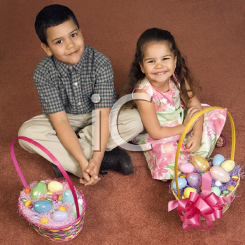 Royalty Free Photo of a Brother and Sister Sitting on a Floor With Easter Baskets Smiling