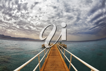 Wooden pier on a beach of Red sea in Eilat