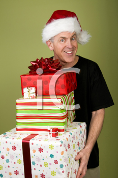 Royalty Free Photo of a Man in a Santa Cap With Presents