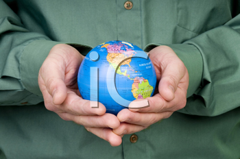 Royalty Free Photo of a Man Holding a Small Globe