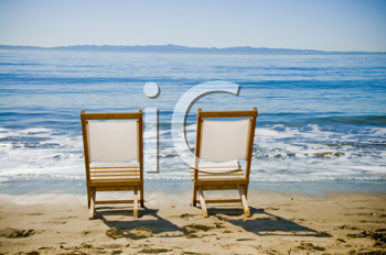 Royalty Free Photo of Two Chairs on the Beach