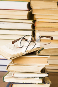 Royalty Free Photo of a Pair of Glasses on Books