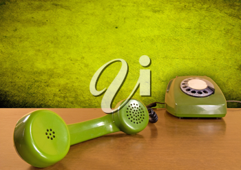Royalty Free Photo of a Vintage Green Telephone