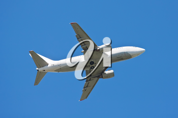 Beautiful white passenger airplane in blue sky