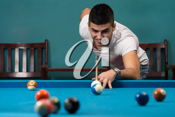 Young Men Lining To Hit Ball On Pool Table