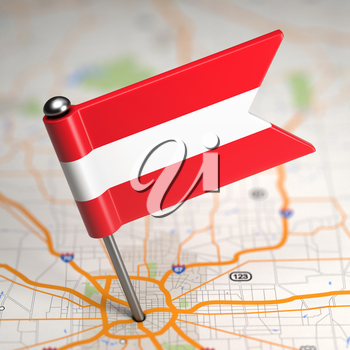 Small Flag of Austria Sticked in the Map Background with Selective Focus.
