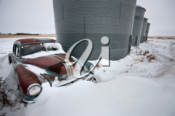 Antique abandoned car pontiac in winter canada