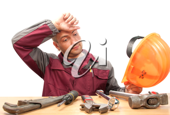 Tired working man with tools. Isolated on white