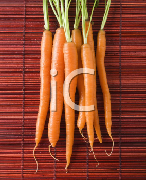 Royalty Free Photo of Carrots on a Bamboo Mat