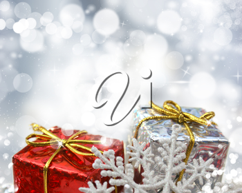 Christmas gifts on a silver bokeh lights background