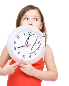 Little girl is holding big clock, isolated over white