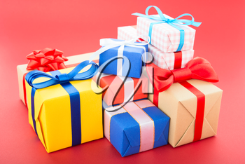 Gift boxes, isolated on red background