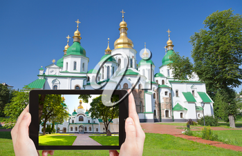 travel concept - tourist taking photo of Saint Sophia Cathedral in Kiev on mobile gadget, Ukraine